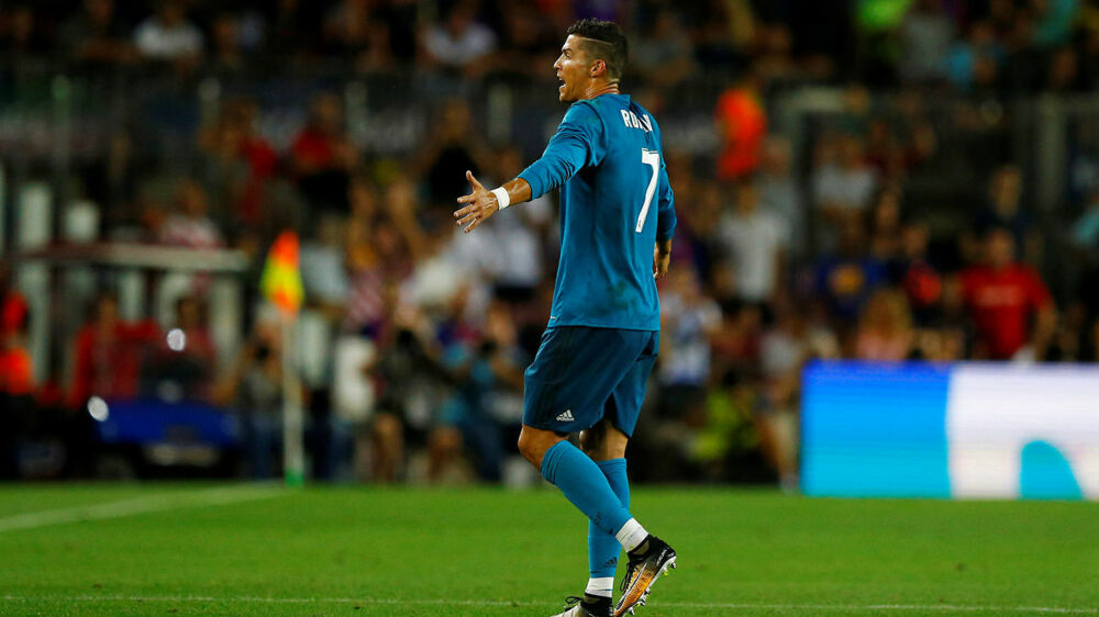 Soccer Football - Barcelona v Real Madrid Spanish Super Cup First Leg - Barcelona, Spain - August 13, 2017 Real Madrid's Cristiano Ronaldo walks off dejected after being sent off REUTERS/Juan Medina