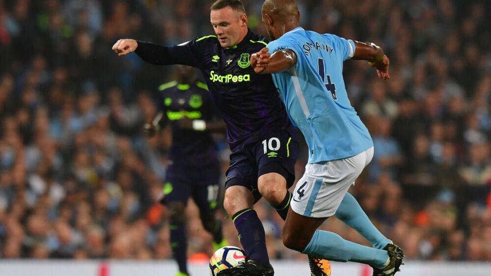 Wayne Rooney, der mandag scorede mod Manchester City, stopper på landsholdet. Scanpix/Anthony Devlin