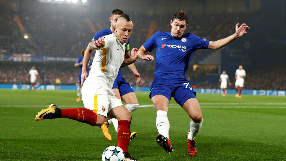 Soccer Football - Champions League - Chelsea vs AS Roma - Stamford Bridge, London, Britain - October 18, 2017 AS Roma's Radja Nainggolan in action with Chelsea's Andreas Christensen Action Images via Reuters/John Sibley