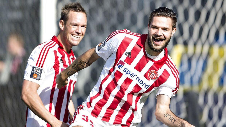 AaB har solgt deres litauiske angriber Lukas Spalvis (th.) til portugisiske Sporting.