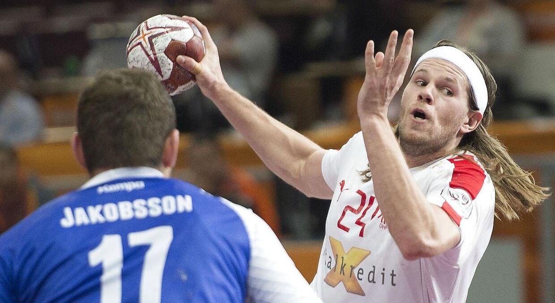 Mikkel Hansen trykker kanonen af mod Island ved sidste års VM i Qatar