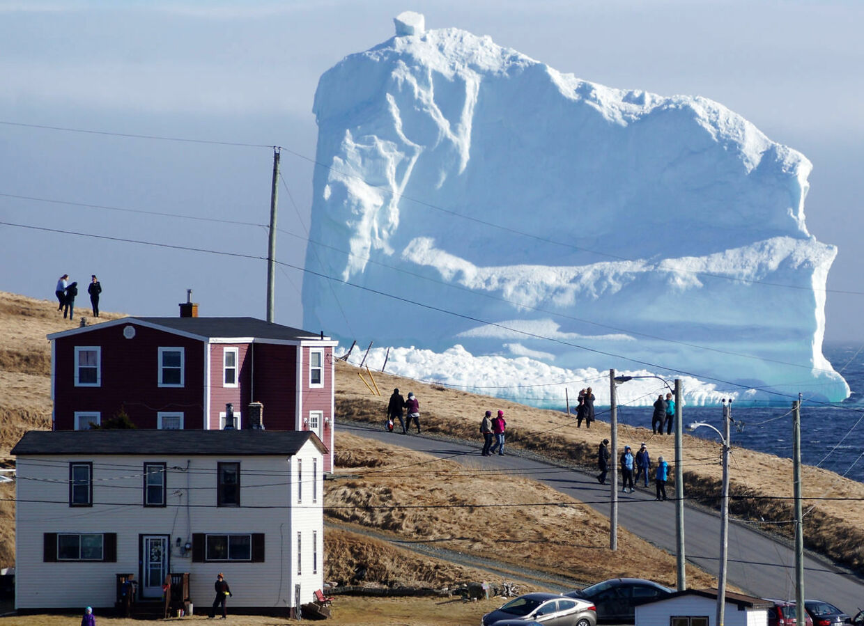 "Residents view the first iceberg of the season as it passes the South Shore, also known as ""Iceberg Alley"", near Ferryland Newfoundland, Canada April 16, 2017. Picture taken April 16, 2017. REUTERS/Jody Martin TPX IMAGES OF THE DAY"