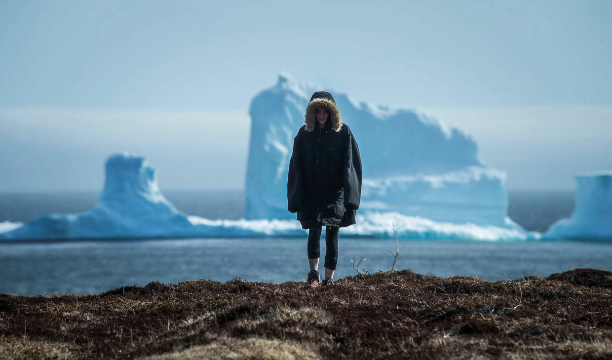 "A resident views the first iceberg of the season as it passes the South Shore, also known as ""Iceberg Alley"", near Ferryland Newfoundland, Canada April 16, 2017. Picture taken April 16, 2017. REUTERS/Greg Locke"