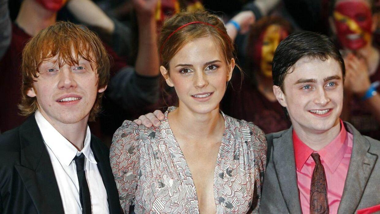 Rupert Grint, der spillede Ron Weasley ses her i 2009 sammen med Emma Watson, der spillede Hermione samt Daniel Radcliffe, der spillede Harry Potter i filmene af samme navn.