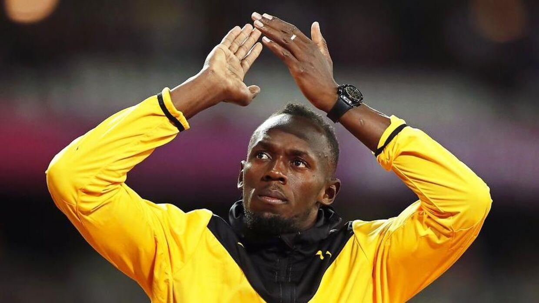 Usain Bolt på sin sidste æresrunde på atletikstadionnet i London.