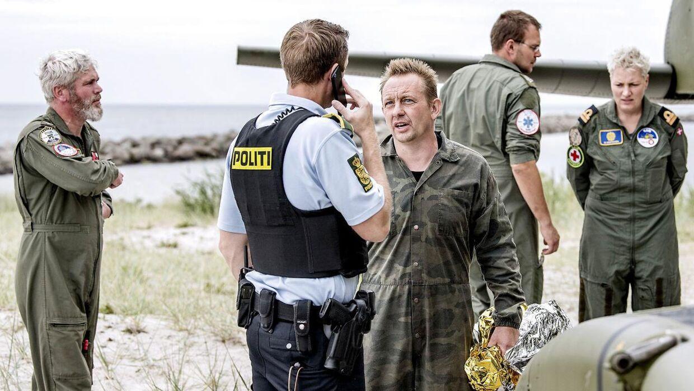 Her de første billeder af Peter Madsen, lige efter ubåden sank mod bunden af Øresund.