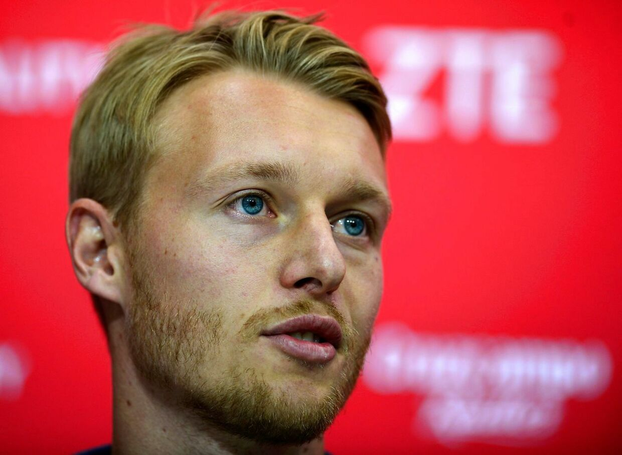 Sevilla's new player Danish defender Simon Kjaer speaks during his official presentation at the Sanchez Pizjuam stadium in Sevilla, on August 3, 2017 / AFP PHOTO / CRISTINA QUICLER