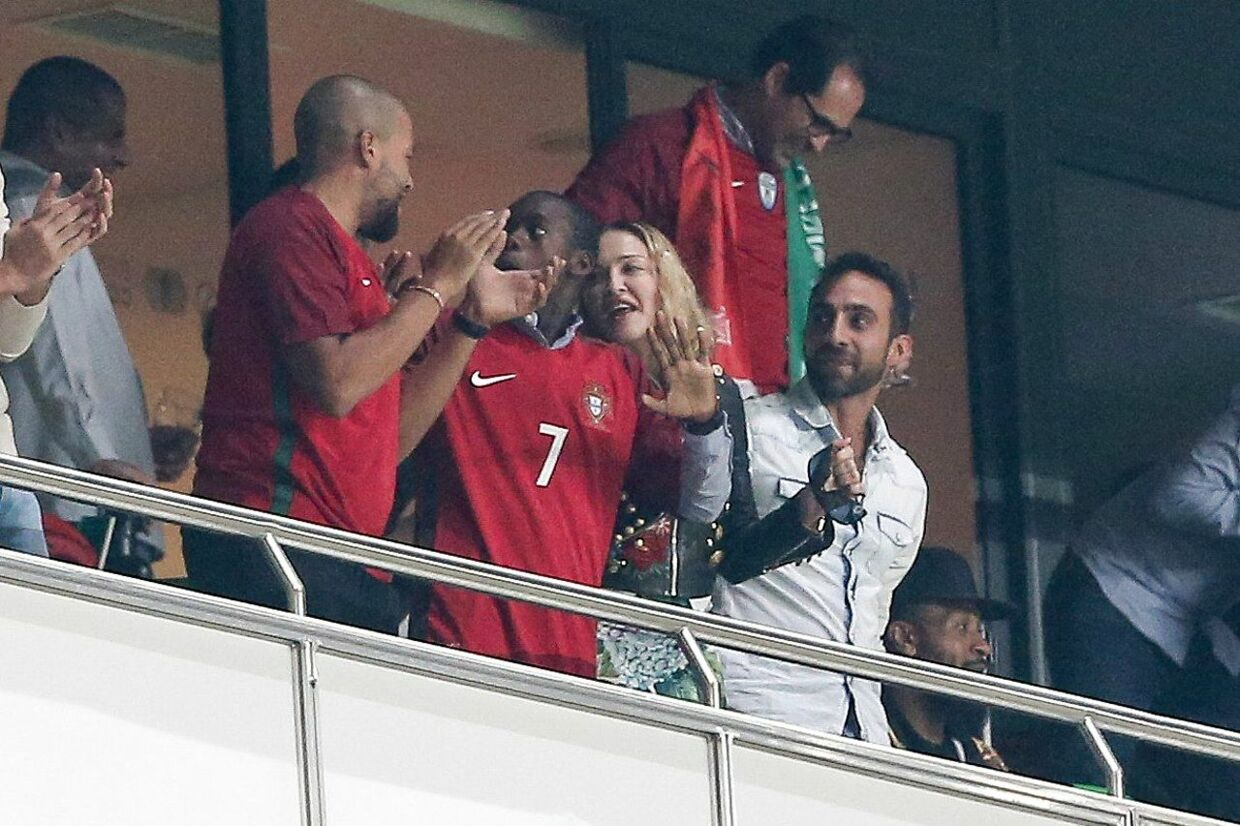 epa06257693 US pop star Madonna (C) watching the Russia 2018 World Cup qualifier match Portugal vs Switzerland at Luz Stadium in Lisbon, Portugal, 10 October 2017. EPA/MIGUEL A. LOPES