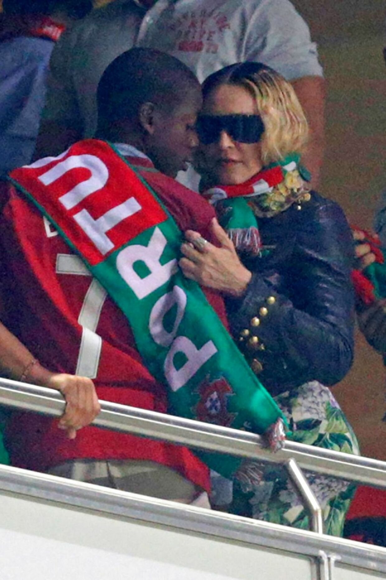 US pop star Madonna (R) and her son David Banda attend during the FIFA World Cup 2018 Group B qualifier football match between Portugal and Switzerland at the Luz Stadium in Lisbon on October 10, 2017. / AFP PHOTO / JOSE MANUEL RIBEIRO