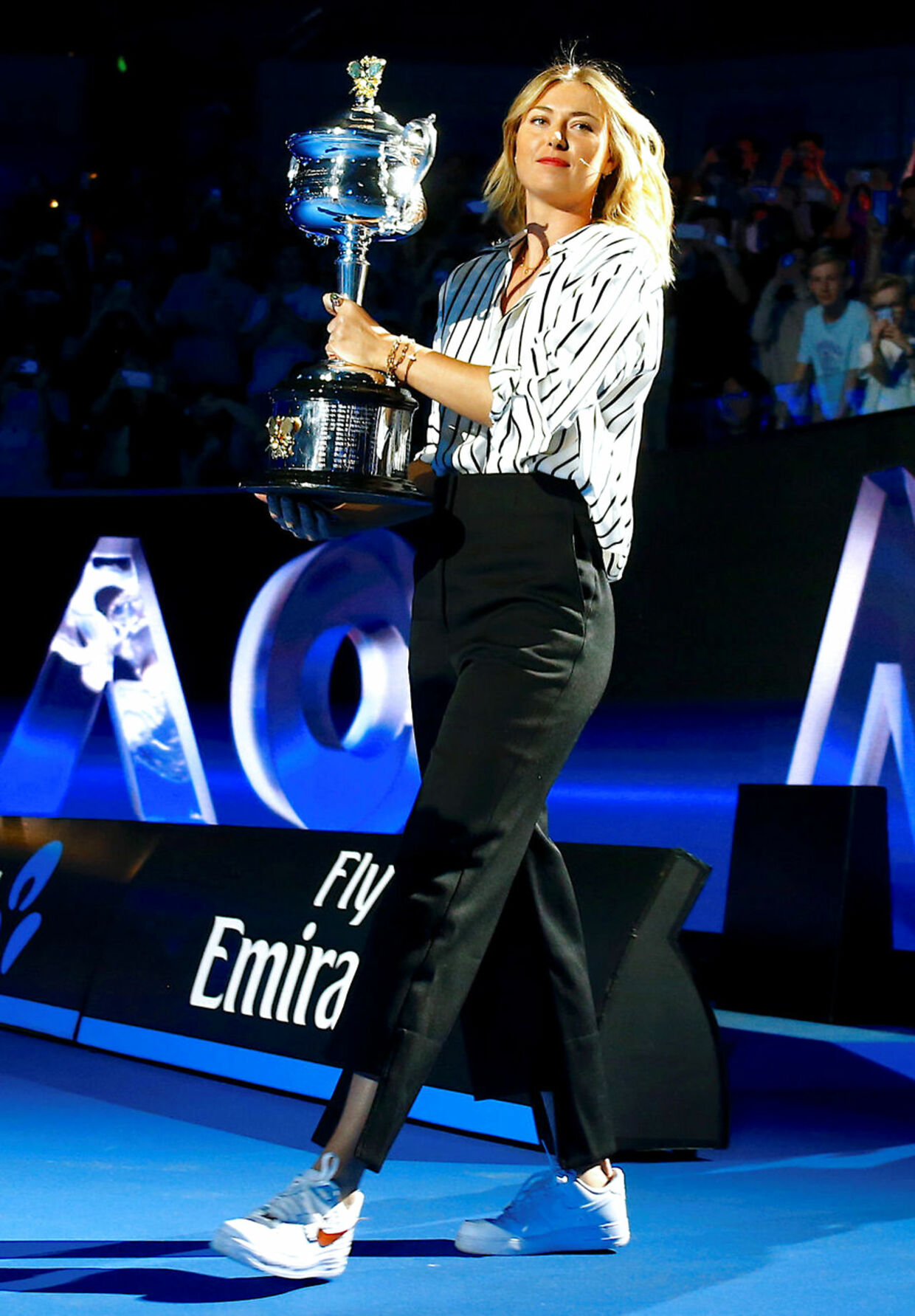 Tennis - Australian Open - Melbourne Park, Melbourne, Australia, January 11, 2018. Russia's Maria Sharapova holds the Women's singles trophy during the official draw ceremony ahead of the Australian Open tennis tournament. REUTERS/David Gray
