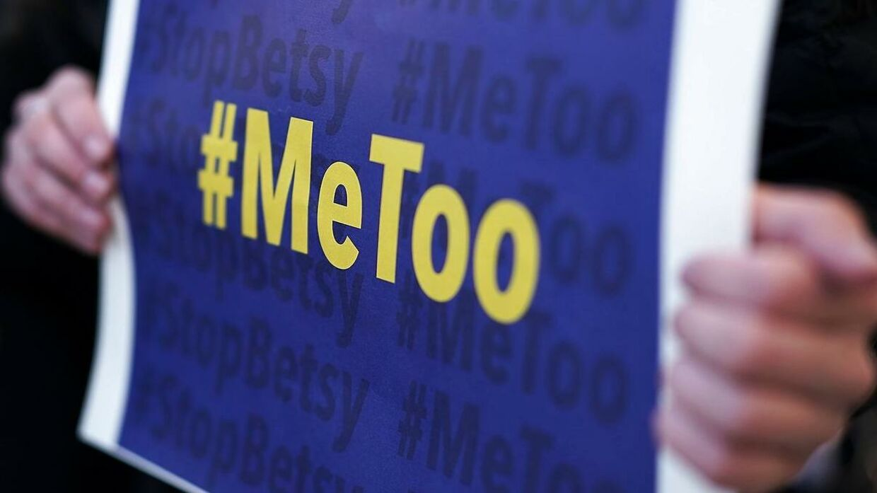 """WASHINGTON, DC - JANUARY 25: An activist holds a #MeToo sign during a news conference on a Title IX lawsuit outside the Department of Education January 25, 2018 in Washington, DC. Anti-sexual harassment groups held a news conference to announce a """"landmark lawsuit against the Trump Administration over Title IX"""" and the """"unconstitutional Title IX policy harming student survivors of sexual violence and harassment."""" Alex Wong/Getty Images/AFP == FOR NEWSPAPERS, INTERNET, TELCOS & TELEVISION USE ONLY =="""