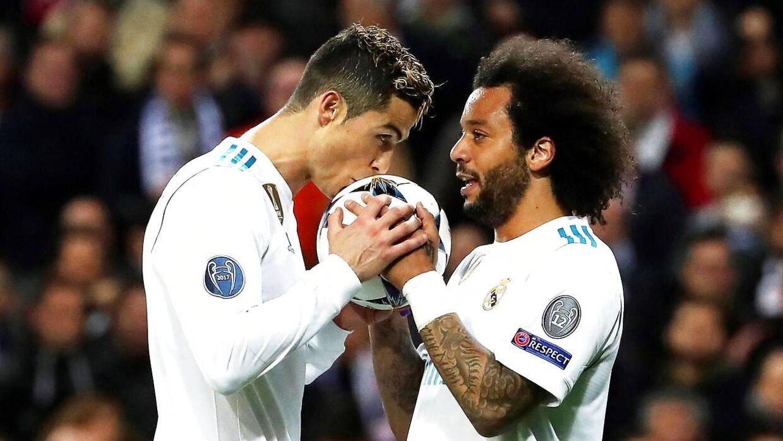 Cristiano Ronaldo (to mål) og Marcelo (th) stod for Real Madrids mål i 3-1 sejren mod Paris Saint-Germain.