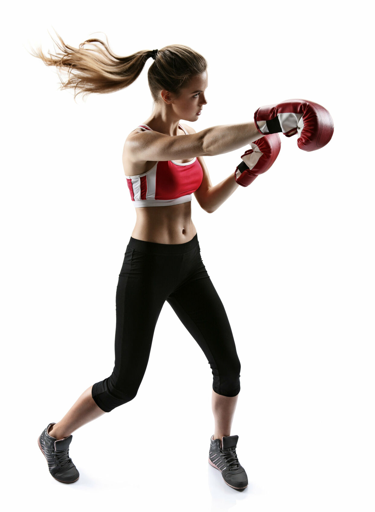 Boxing woman punching wearing boxing gloves / photo set of sporty muscular female brunette girl wearing sports clothes over white background