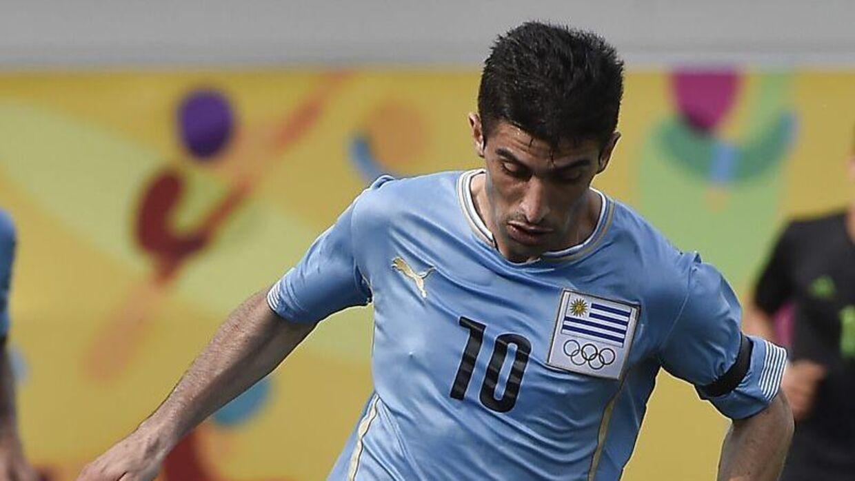 Michael Santos ved Pan American Games mod Mexico. Lykkes det FC København at slå kløerne i den uruguayanske angriber, kan han potentielt blive Superligaens dyreste spiller.
