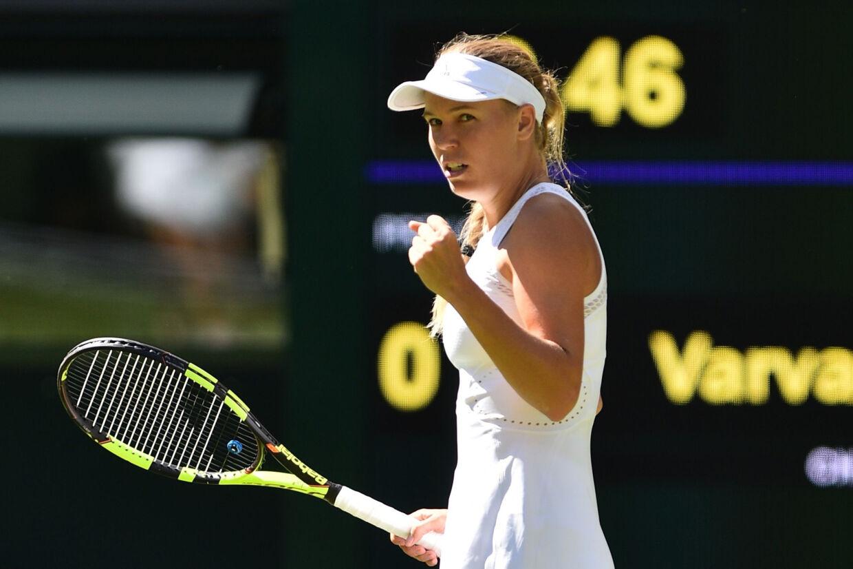 Caroline Wozniacki træder ind på Wimbledons græs igen onsdag eftermiddag. Glyn Kirk/Ritzau Scanpix