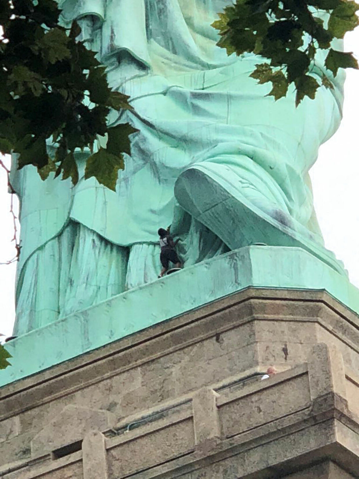 A protester is seen on the Statue of Liberty in New York, New York, U.S., July 4, 2018 in this picture obtained from social media. Danny Owens/via REUTERS THIS IMAGE HAS BEEN SUPPLIED BY A THIRD PARTY. MANDATORY CREDIT.NO RESALES.NO ARCHIVES