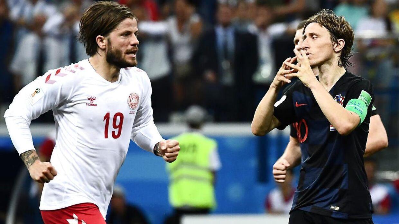 Luka Modric (th.) og resten af det kroatiske mandskab slog Danmark.