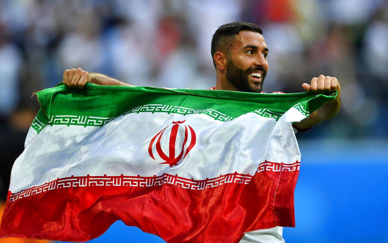 Saman Ghoddos jubler efter Irans indledende VM-sejr over Marokko.