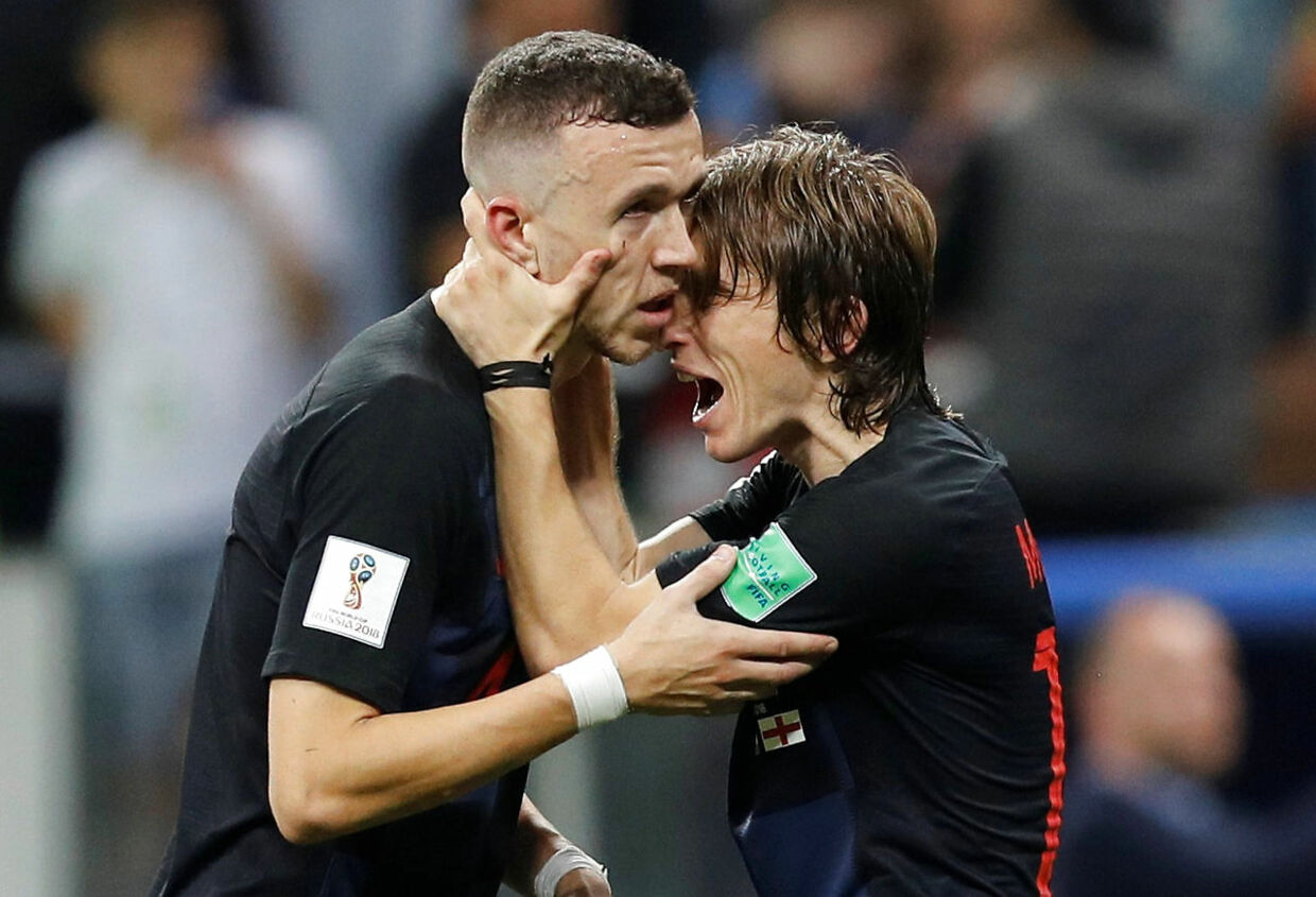 Soccer Football - World Cup - Semi Final - Croatia v England - Luzhniki Stadium, Moscow, Russia - July 11, 2018 Croatia's Ivan Perisic and Luka Modric celebrate after the match REUTERS/Darren Staples
