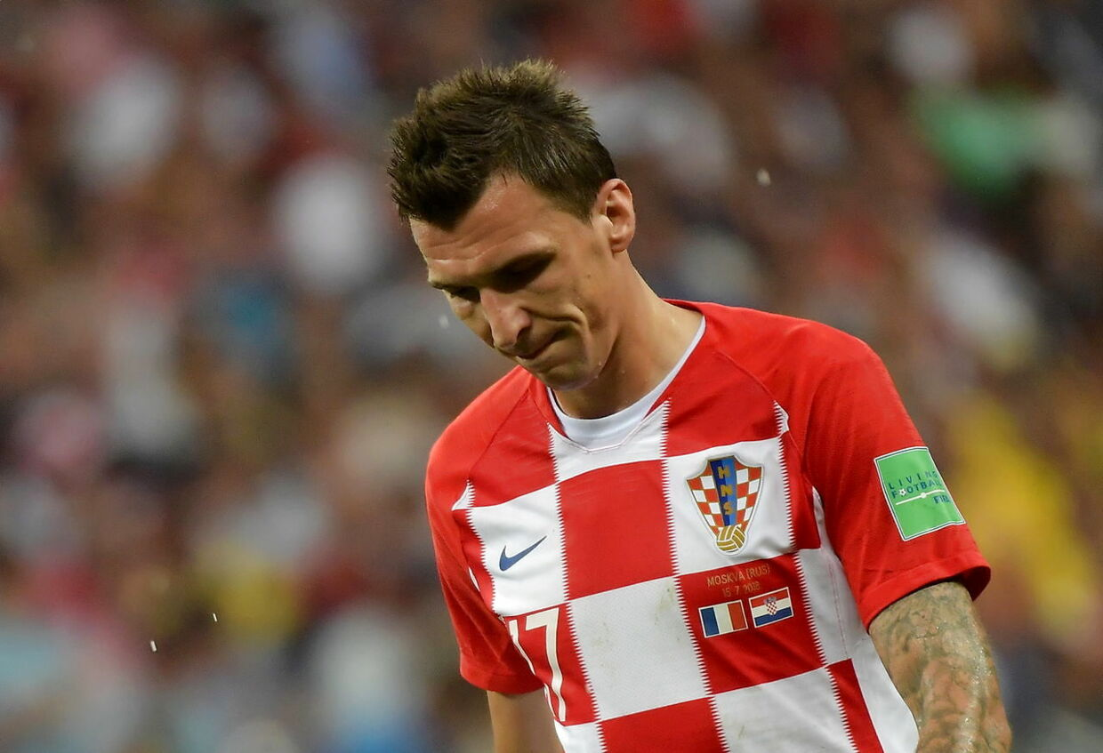 epa06890618 Mario Mandzukic of Croatia reacts during the FIFA World Cup 2018 final between France and Croatia in Moscow, Russia, 15 July 2018. (RESTRICTIONS APPLY: Editorial Use Only, not used in association with any commercial entity - Images must not be used in any form of alert service or push service of any kind including via mobile alert services, downloads to mobile devices or MMS messaging - Images must appear as still images and must not emulate match action video footage - No alteration is made to, and no text or image is superimposed over, any published image which: (a) intentionally obscures or removes a sponsor identification image; or (b) adds or overlays the commercial identification of any third party which is not officially associated with the FIFA World Cup) EPA/PETER POWELL EDITORIAL USE ONLY
