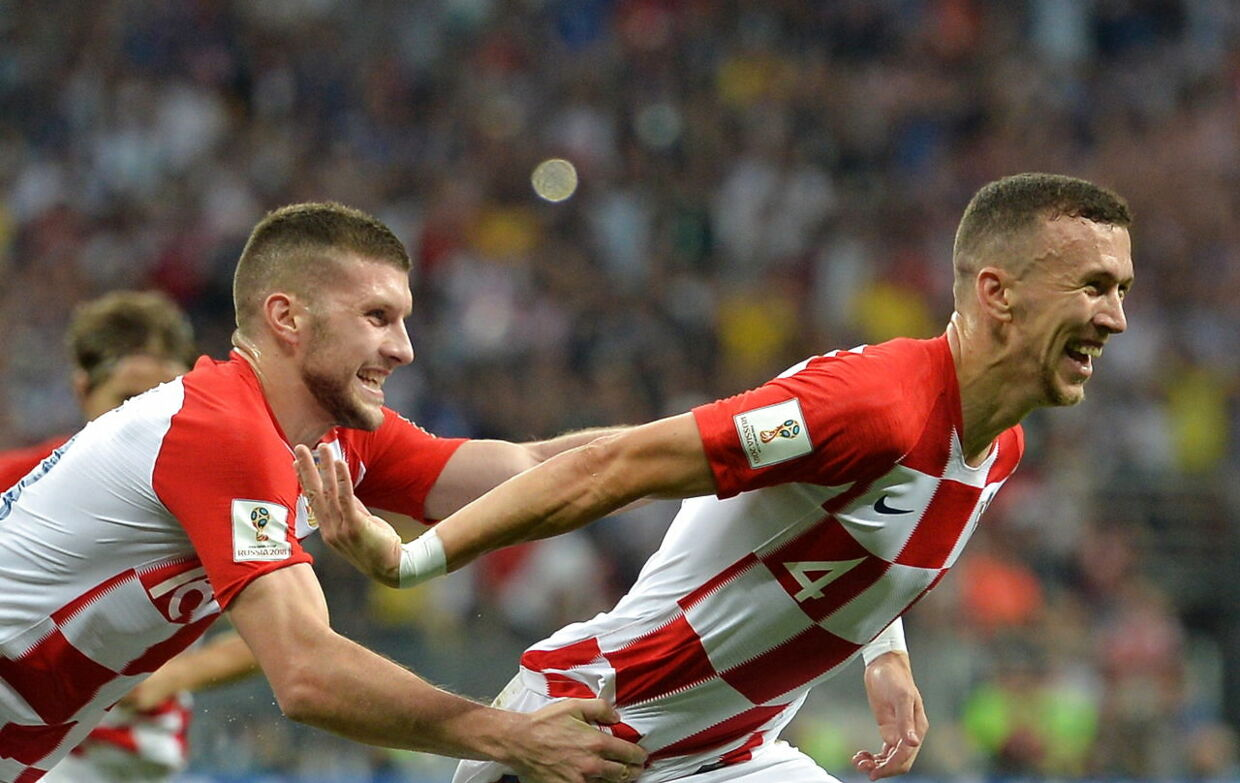 epaselect epa06890666 Ivan Perisic (R) of Croatia celebrates scoring the equalizer during the FIFA World Cup 2018 final between France and Croatia in Moscow, Russia, 15 July 2018. (RESTRICTIONS APPLY: Editorial Use Only, not used in association with any commercial entity - Images must not be used in any form of alert service or push service of any kind including via mobile alert services, downloads to mobile devices or MMS messaging - Images must appear as still images and must not emulate match action video footage - No alteration is made to, and no text or image is superimposed over, any published image which: (a) intentionally obscures or removes a sponsor identification image; or (b) adds or overlays the commercial identification of any third party which is not officially associated with the FIFA World Cup) EPA/PETER POWELL EDITORIAL USE ONLY
