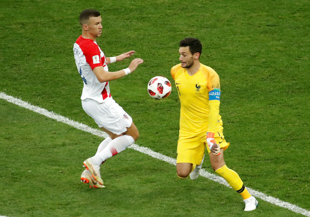 Soccer Football - World Cup - Final - France v Croatia - Luzhniki Stadium, Moscow, Russia - July 15, 2018 France's Hugo Lloris in action with Croatia's Ivan Perisic REUTERS/Christian Hartmann