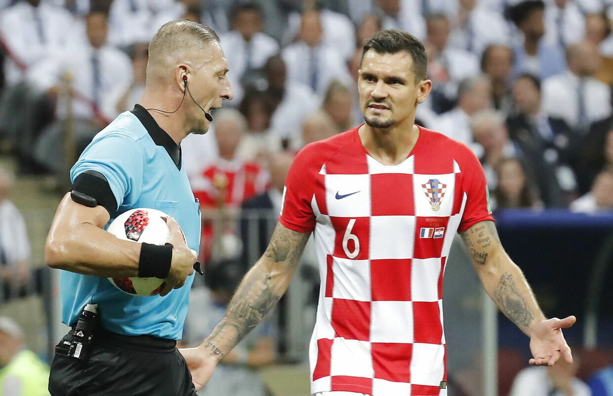 epa06890751 Dejan Lovren of Croatia talks to Argentinian referee Nestor Pitana (L) during the FIFA World Cup 2018 final between France and Croatia in Moscow, Russia, 15 July 2018. (RESTRICTIONS APPLY: Editorial Use Only, not used in association with any commercial entity - Images must not be used in any form of alert service or push service of any kind including via mobile alert services, downloads to mobile devices or MMS messaging - Images must appear as still images and must not emulate match action video footage - No alteration is made to, and no text or image is superimposed over, any published image which: (a) intentionally obscures or removes a sponsor identification image; or (b) adds or overlays the commercial identification of any third party which is not officially associated with the FIFA World Cup) EPA/FELIPE TRUEBA EDITORIAL USE ONLY