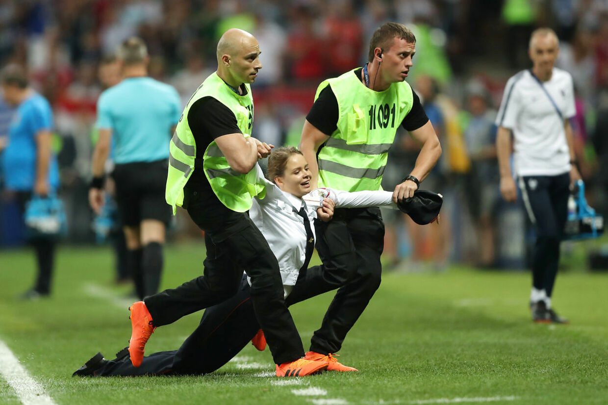 Soccer Football - World Cup - Final - France v Croatia - Luzhniki Stadium, Moscow, Russia - July 15, 2018 Stewards apprehend a pitch invader REUTERS/Carl Recine