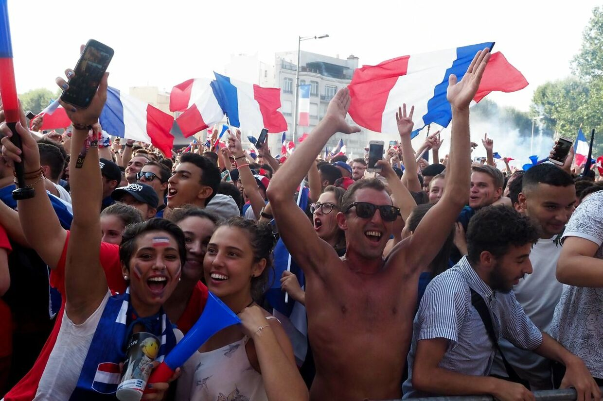 People watch the Russia 2018 World Cup final football match between France and Croatia in Perpignan on July 15, 2018. / AFP PHOTO / RAYMOND ROIG