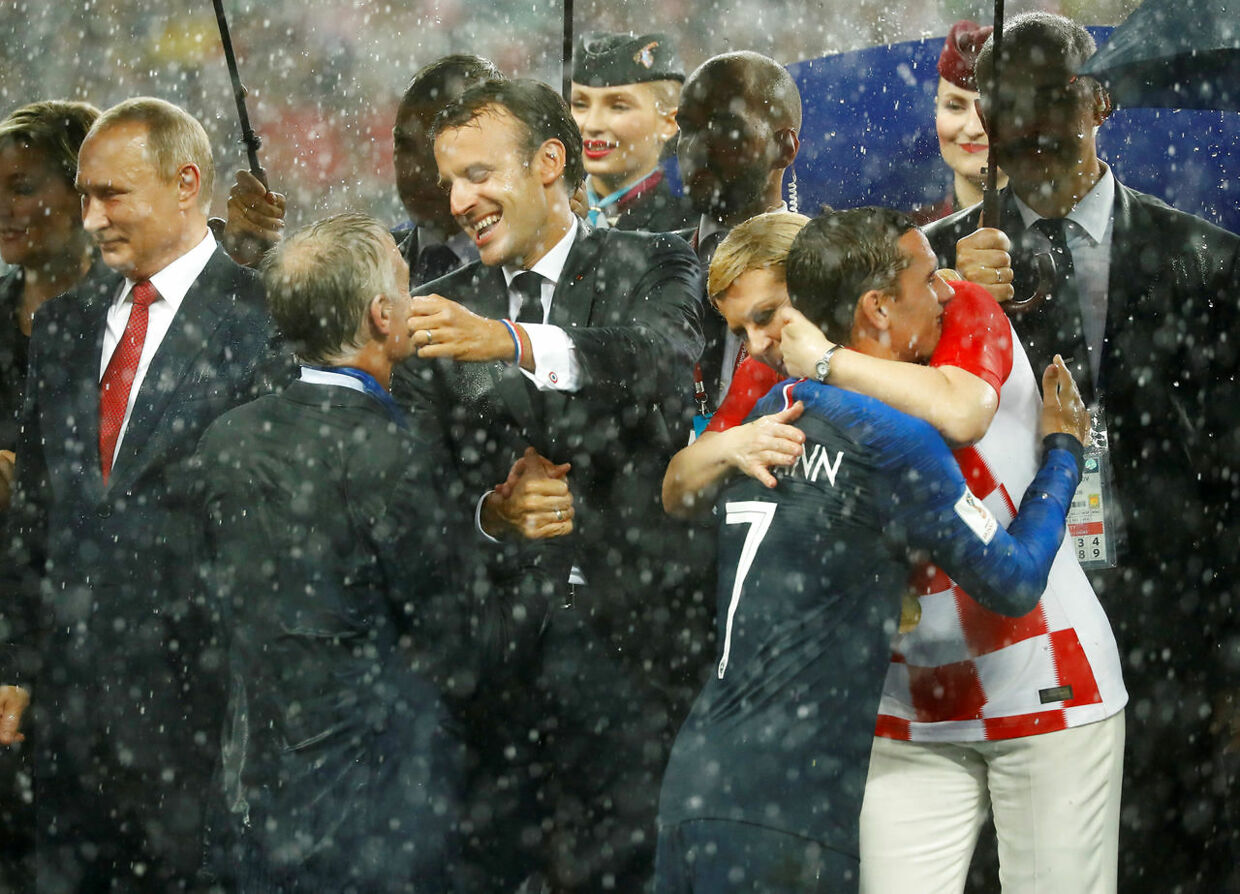 Soccer Football - World Cup - Final - France v Croatia - Luzhniki Stadium, Moscow, Russia - July 15, 2018 France coach Didier Deschamps celebrates with President of France Emmanuel Macron after winning the World Cup as President of Croatia Kolinda Grabar-Kitarovic hugs France's Antoine Griezmann REUTERS/Kai Pfaffenbach