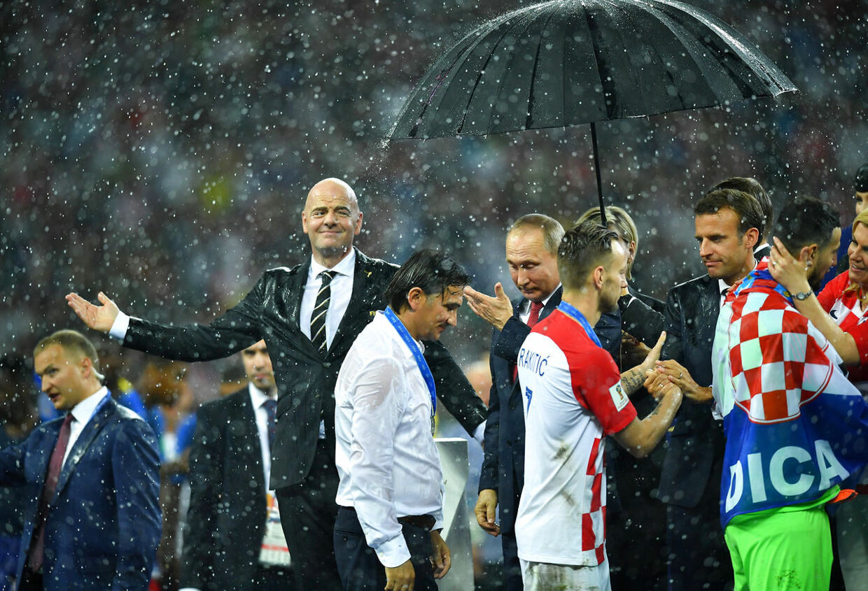 Soccer Football - World Cup - Final - France v Croatia - Luzhniki Stadium, Moscow, Russia - July 15, 2018 FIFA president Gianni Infantino reacts as President of Russia Vladimir Putin gestures and President of France Emmanuel Macron shakes hands with Croatia's Ivan Rakitic REUTERS/Dylan Martinez