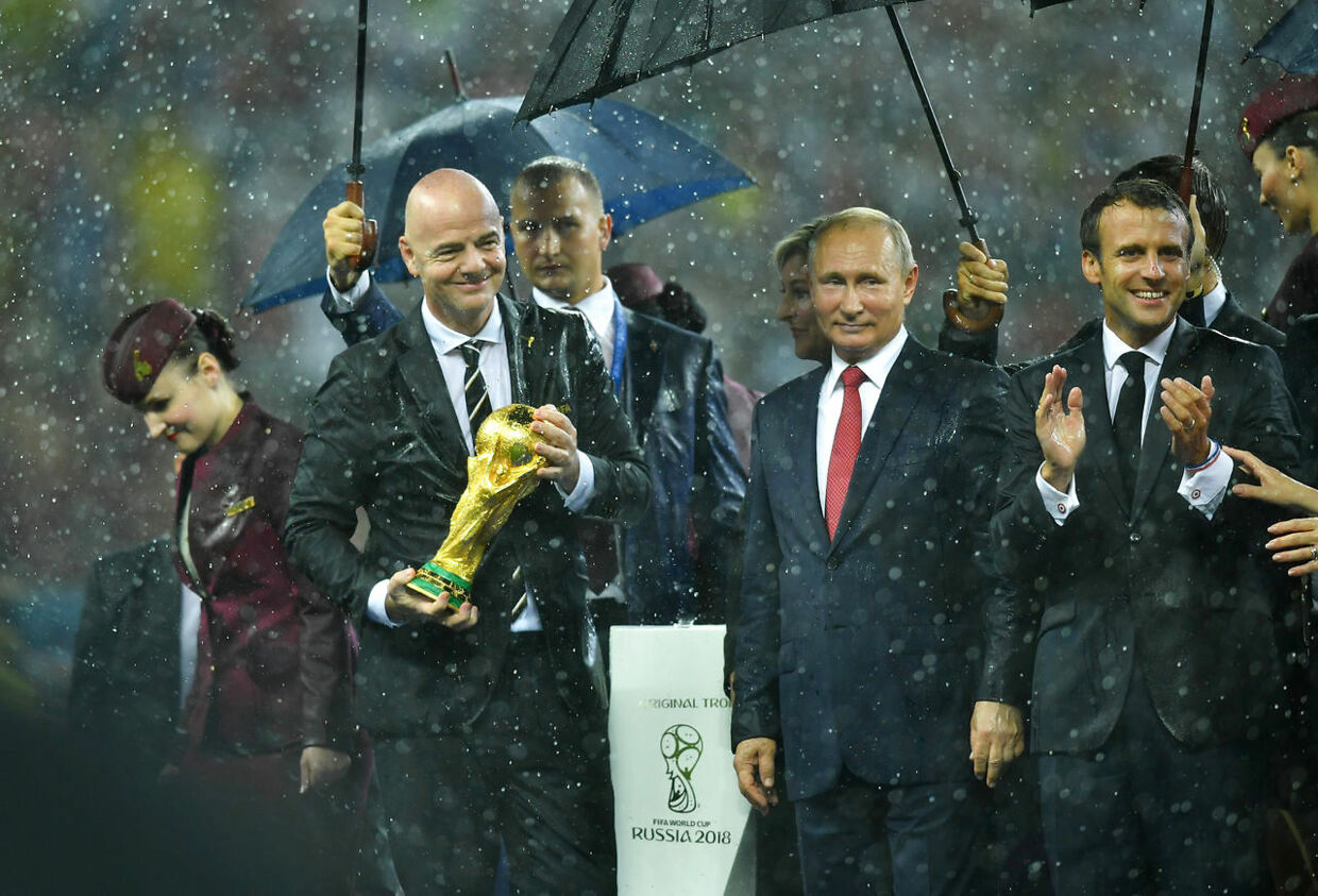 Soccer Football - World Cup - Final - France v Croatia - Luzhniki Stadium, Moscow, Russia - July 15, 2018 FIFA president Gianni Infantino holds the World Cup trophy as President of Russia Vladimir Putin and President of France Emmanuel Macron react REUTERS/Dylan Martinez