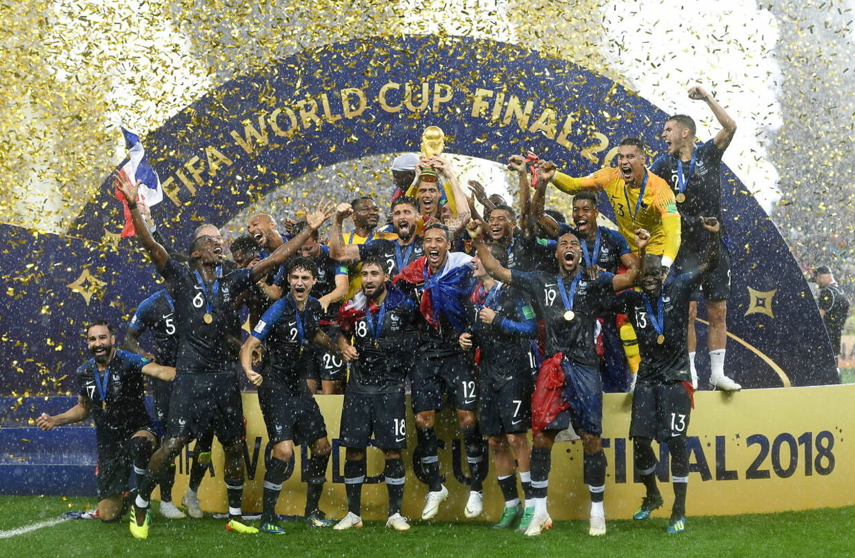epa06891477 French player react with the trophy after winning the FIFA World Cup 2018 final between France and Croatia in Moscow, Russia, 15 July 2018. (RESTRICTIONS APPLY: Editorial Use Only, not used in association with any commercial entity - Images must not be used in any form of alert service or push service of any kind including via mobile alert services, downloads to mobile devices or MMS messaging - Images must appear as still images and must not emulate match action video footage - No alteration is made to, and no text or image is superimposed over, any published image which: (a) intentionally obscures or removes a sponsor identification image; or (b) adds or overlays the commercial identification of any third party which is not officially associated with the FIFA World Cup) EPA/FACUNDO ARRIZABALAGA EDITORIAL USE ONLY