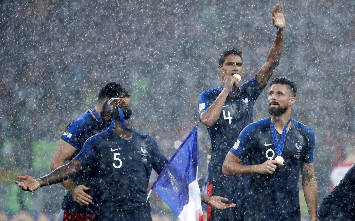 Soccer Football - World Cup - Final - France v Croatia - Luzhniki Stadium, Moscow, Russia - July 15, 2018 France's Adil Rami, Samuel Umtiti, Raphael Varane and Olivier Giroud celebrate with their medals after winning the World Cup REUTERS/Damir Sagolj