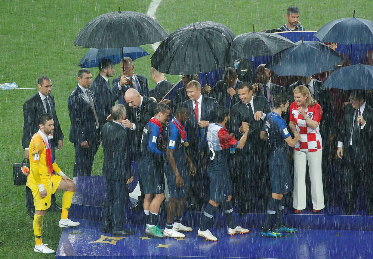 Soccer Football - World Cup - Final - France v Croatia - Luzhniki Stadium, Moscow, Russia - July 15, 2018 France players and coach Didier Deschamps receive their winners medals from FIFA president Gianni Infantino, President of Russia Vladimir Putin, President of France Emmanuel Macron and President of Croatia Kolinda Grabar-Kitarovic during the medals presentation REUTERS/Maxim Shemetov