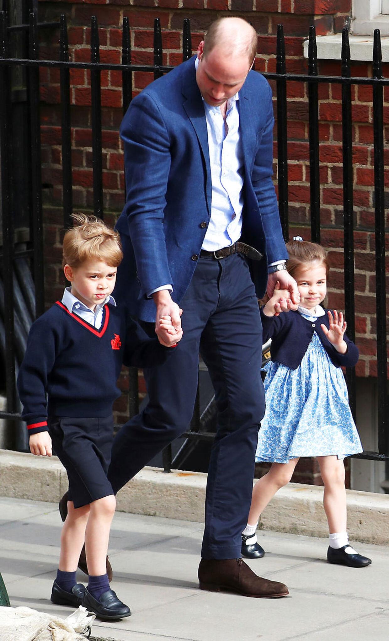 Prins William, prins George og prinsesse Charlotte. (Foto: Hannah McKay/Reuters)