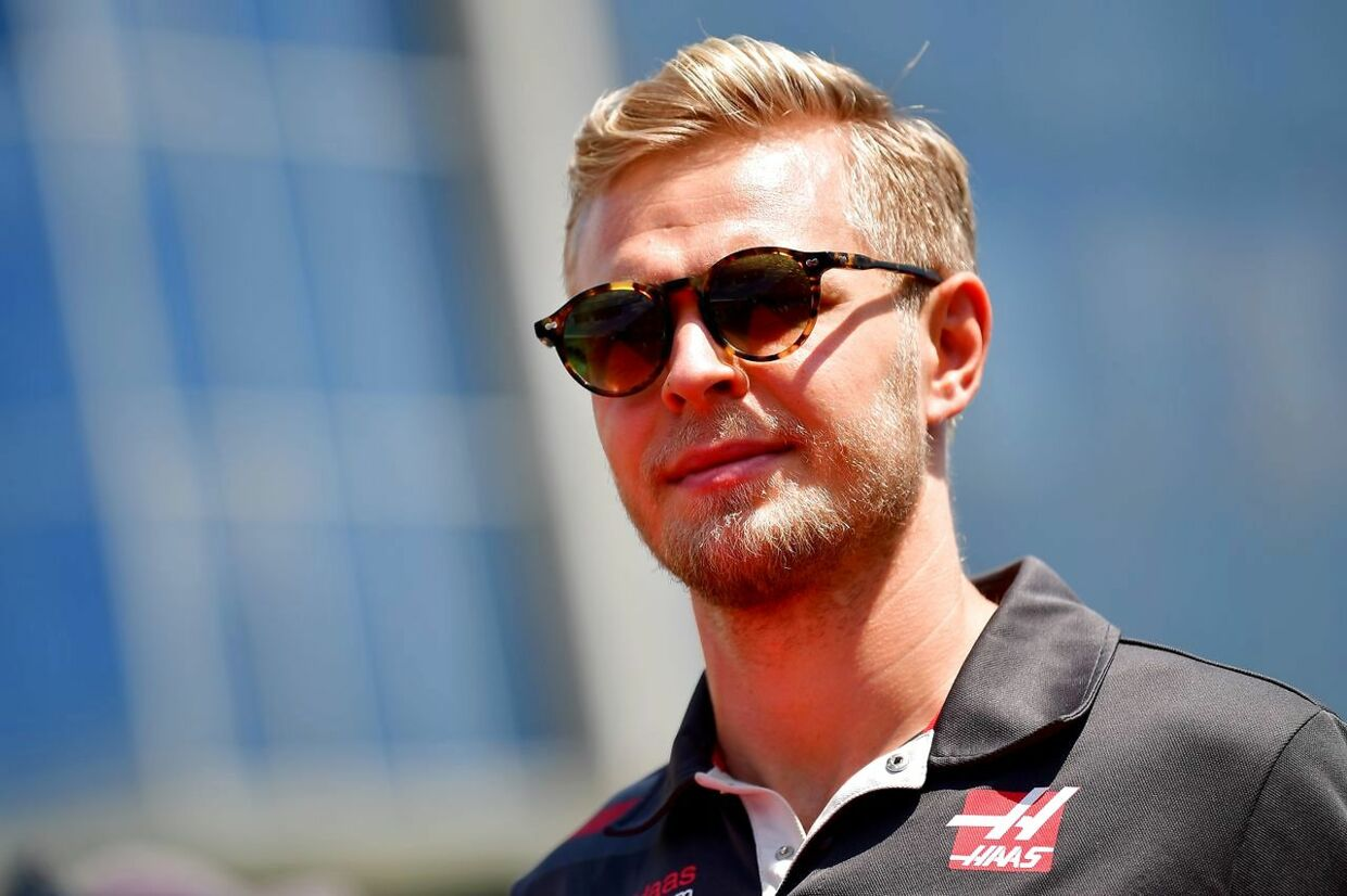 Haas F1's Danish driver Kevin Magnussen walks down the paddock prior to the race of the Formula One Hungarian Grand Prix at the Hungaroring circuit in Mogyorod near Budapest, Hungary, on July 29, 2018. / AFP PHOTO / ANDREJ ISAKOVIC