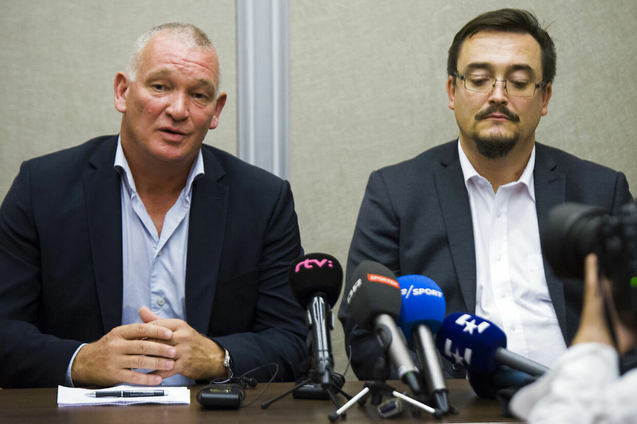 Danish national soccer team caretaker manager John Jensen, left and Sport director DBU Kim Hallberg, listen to a question during a press conference at the Rivar Park hotel in Bratislava, Slovakia Tuesday, Sept. 4, 2018. Slovakia will play against Denmark in a friendly soccer game on Sept. 5. (Jakub Kotian/TASR via AP)