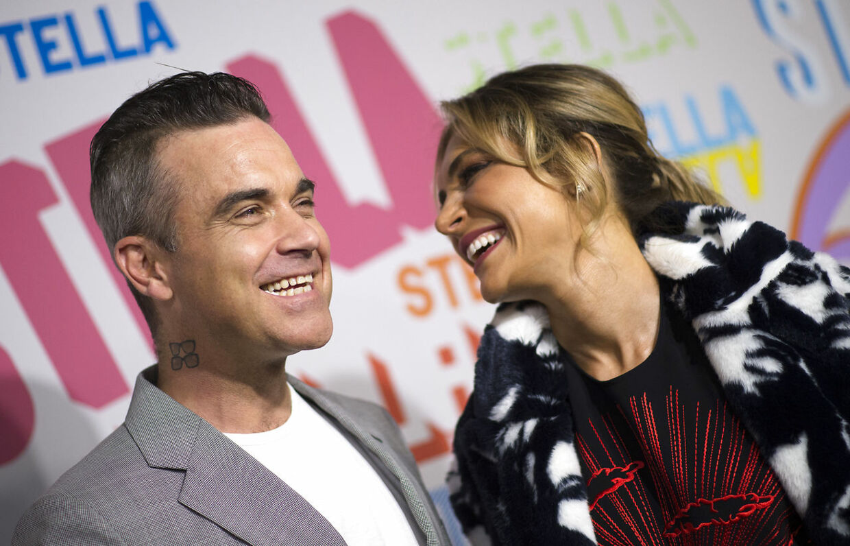 Singer Robbie Williams and actress Ayda Field attend the Stella McCartney Autumn 2018 womenswear collection and Autumn Winter 2018 menswear collection on January 16, 2018, in Hollywood, California. VALERIE MACON / AFP