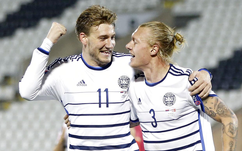 Simon Kjær og Bendtner i 2014.
