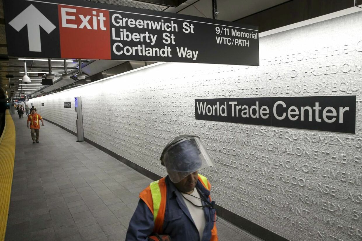 NEW YORK, NY - SEPTEMBER 10: Workers walk along the platform at the newly opened Cortland Street 1 train station September 10, 2018 in New York City. The Cortland Street 1 train station was buried in debris following the 9/11 terrorist attacks and had been closed since that day 17 years ago. The newly renovated version of the station opened on Saturday. Drew Angerer/Getty Images/AFP == FOR NEWSPAPERS, INTERNET, TELCOS & TELEVISION USE ONLY ==