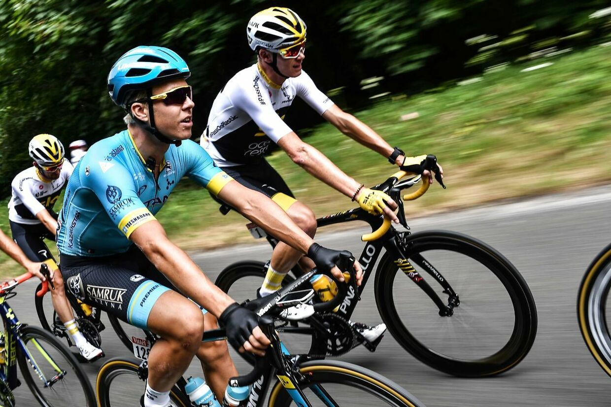 Denmark's Michael Valgren (L) and Great Britain's Christopher Froome ride during the 21st and last stage of the 105th edition of the Tour de France cycling race between Houilles and Paris Champs-Elysees, on July 29, 2018. / AFP PHOTO / Jeff PACHOUD