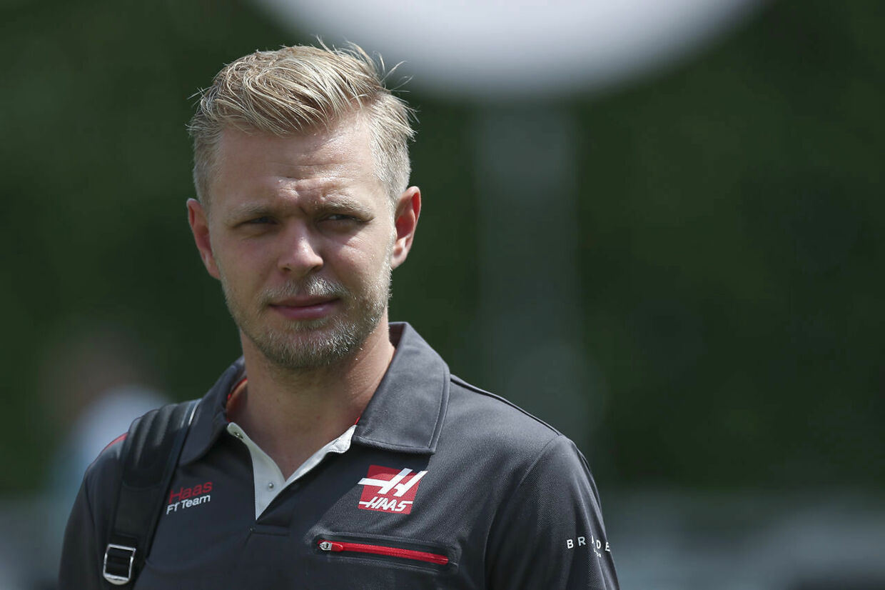 Haas Driver Kevin Magnussen of Denmark arrives at the Marina Bay City Circuit ahead of the Singapore Formula One Grand Prix in Singapore, Friday, Sept. 14, 2018. (AP Photo/Yong Teck Lim)