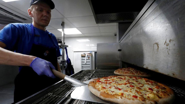 Arkiv. Butikschefer hos Domino's har haft en økonomisk gevinst ved at nedbringe madspildet i butikkerne.