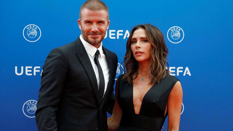 David Beckham med sin kone Victoria.