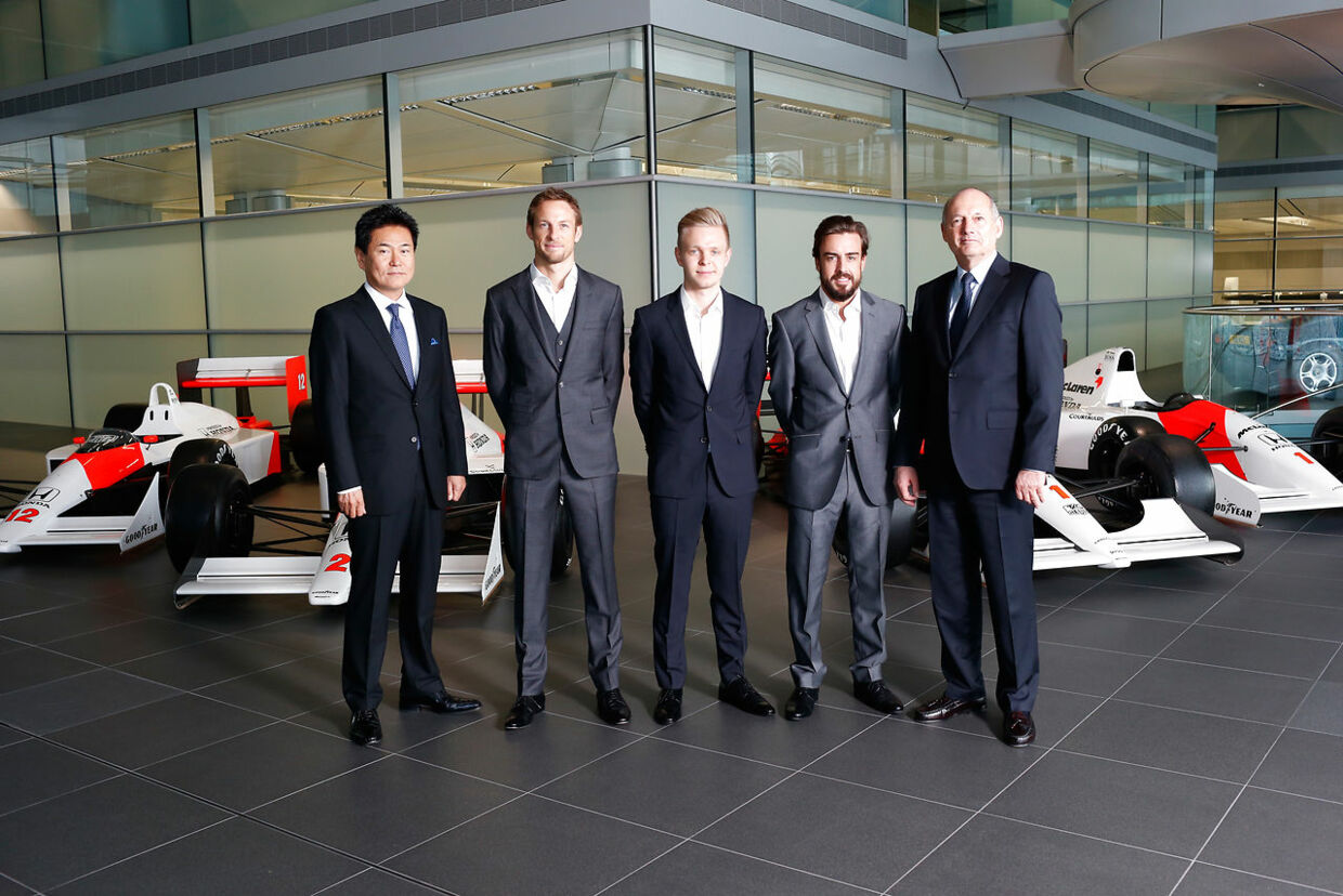 "A handout picture courtesy of McLaren-Honda shows (L-R) Honda's motorsport chief Yasuhisa Arai, British Formula One driver Jenson Button, Danish Formula One driver Kevin Magnussen, Spanish Formula One driver Fernando Alonso and executive chairman of McLaren Automotive Ron Dennis pose for a picture in Woking, Surrey, on December 11, 2014. Jenson Button will remain at McLaren to partner returning driver Fernando Alonso in 2015, the British Formula One team announced. AFP PHOTO / HO /  MCLAREN-HONDA. == RESTRICTED TO EDITORIAL USE - MANDATORY CREDIT ""AFP PHOTO / MCLAREN-HONDA "" - NO MARKETING NO ADVERTISING CAMPAIGNS - DISTRIBUTED AS A SERVICE TO CLIENTS ==. McLaren-Honda / AFP"