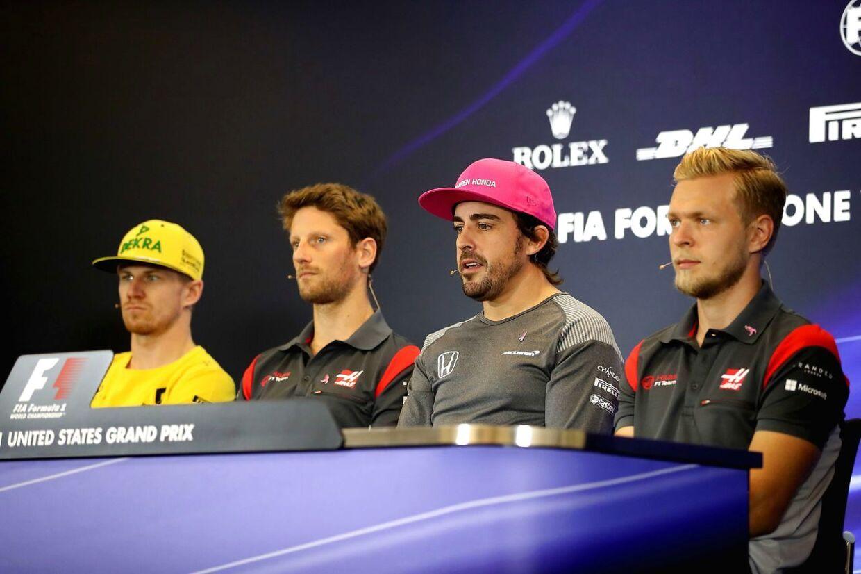 Kevin Magnussen og Fernando Alonso bliver aldrig perlevenner. (Clive Mason/Getty Images/AFP)