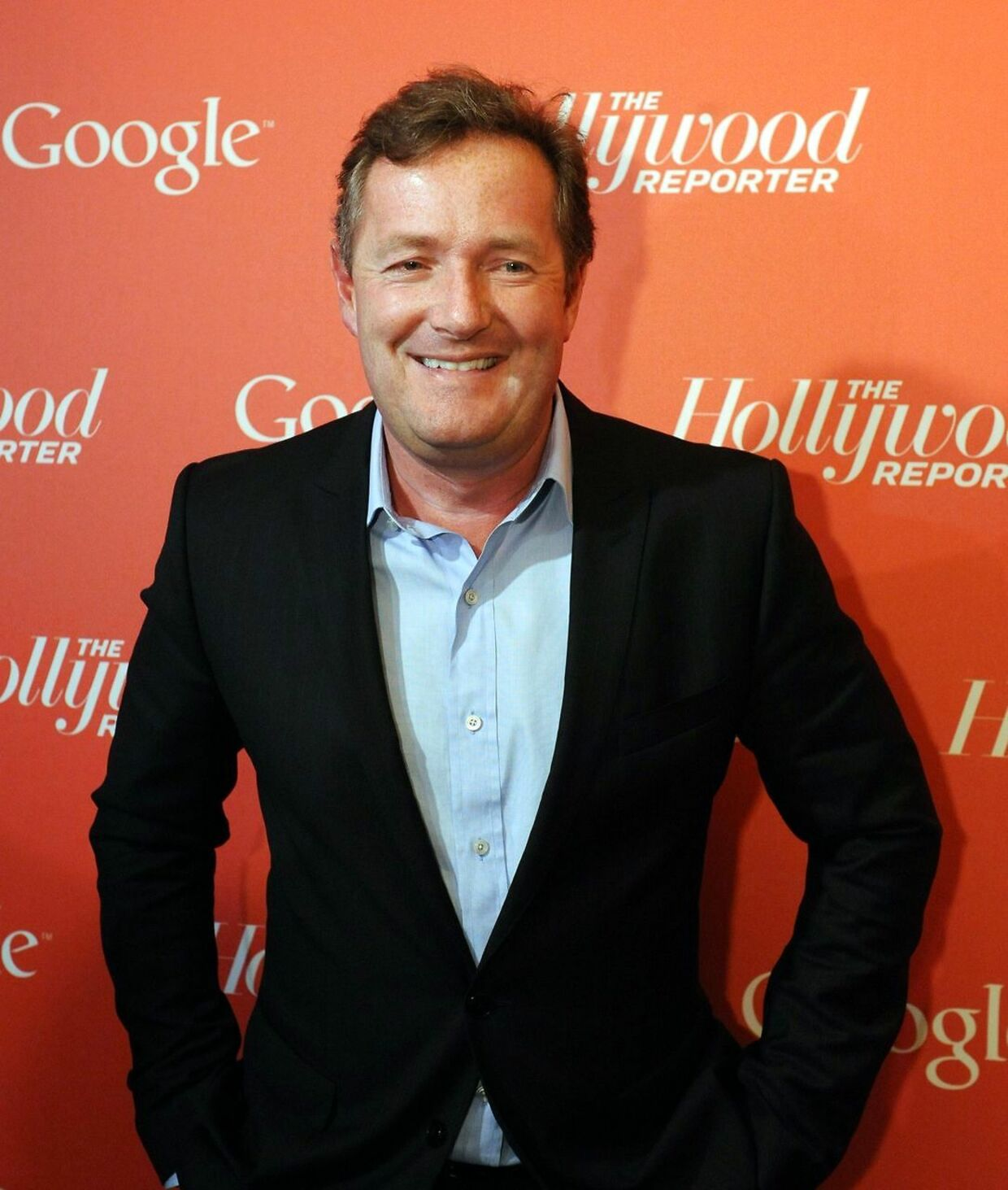 (FILES)CNN's Piers Morgan arrives at a red carpet event hosted by Google and the Hollywood Reporter on the eve of the annual White House Correspondents' Association dinner in Washington in this April 27, 2012 file photo. US gun rights advocates have signed a White House petition calling for British CNN host Piers Morgan to be deported for allegedly attacking the Second Amendment rights of ordinary Americans. The outspoken former British tabloid editor has launched something of a personal crusade for greater gun control measures in the wake of the December 14 massacre at Sandy Hook elementary in Newtown, Connecticut. On December 18, 2012, Morgan held an especially contentious interview with executive director of Gun Owners of America Larry Pratt, appearing to become incensed and incredulous when Pratt suggested more, not fewer, weapons as the solution. AFP PHOTO / Nicholas KAMM / FILES
