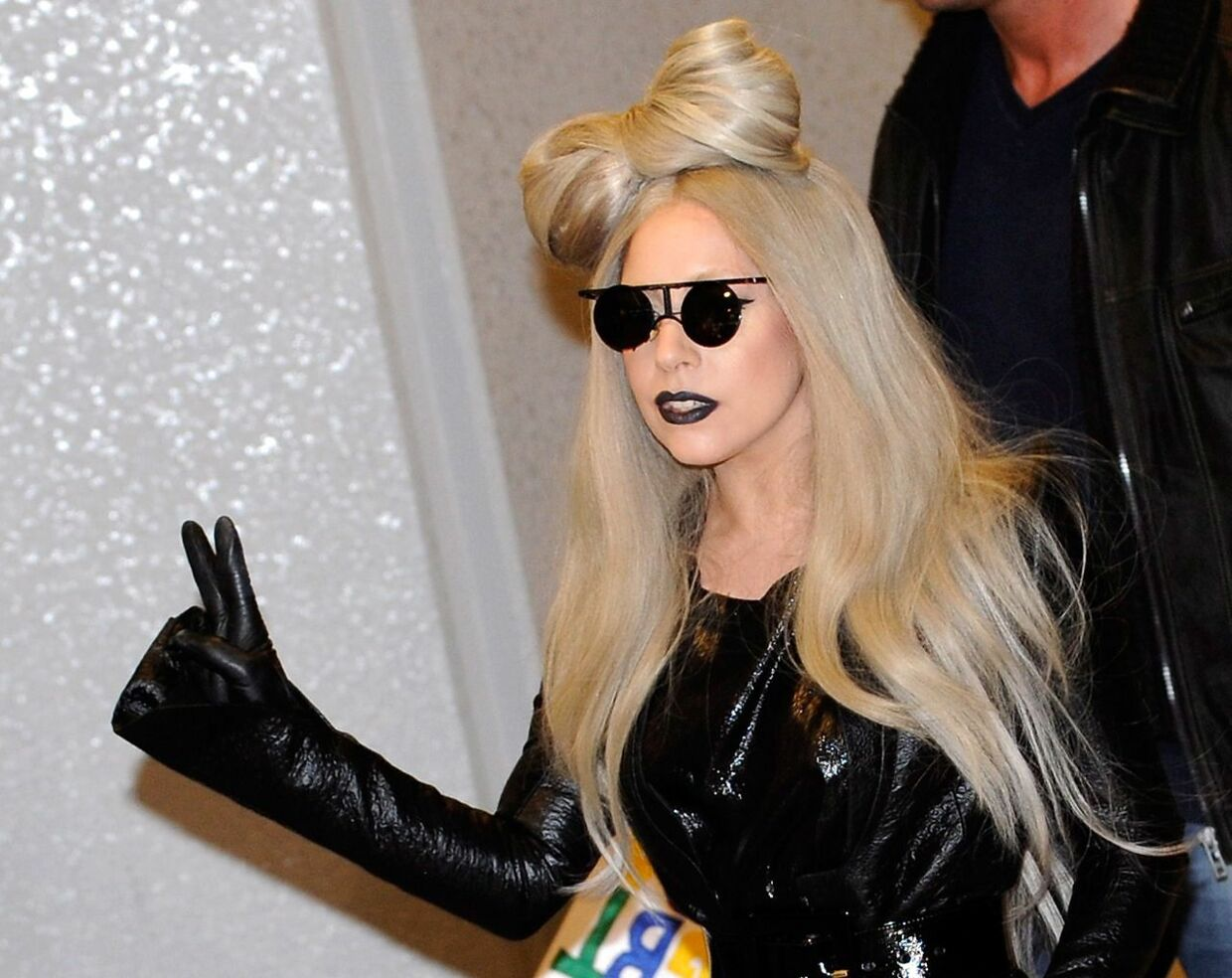 epa03043493 (FILE) A file picture dated 20 December 2011 shows US singer Lady Gaga arriving at Narita International Airport, near Tokyo, Japan. A former assistant to Lady Gaga is suing the pop superstar for 380, 000 dollars, claiming that the Poker Face singer forced her to work more than 7, 000 hours of overtime during the Monster Ball world tour last year. According to the New York Post Monday, Jennifer Oââ // ËNeill, 41, was the former personal assistant to Lady Gaga. She claimed in the court filing that she was forced to work around the clock to cater to the star's every whim, ensuring 'the promptness of a towel following a shower and serving as a personal alarm clock to keep (Gaga) on schedule.' EPA/FRANCK ROBICHON *** Local Caption *** 00000403039271
