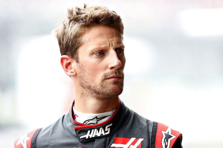 Romain Grosjean og Kevin Magnussen kommer i hård kamp. (Mark Thompson/Getty Images/AFP)